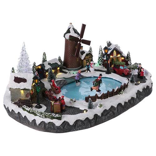 Villaggio Natale 20x45x30 cm albero mulino pattinatori mov batteria e corrente 4