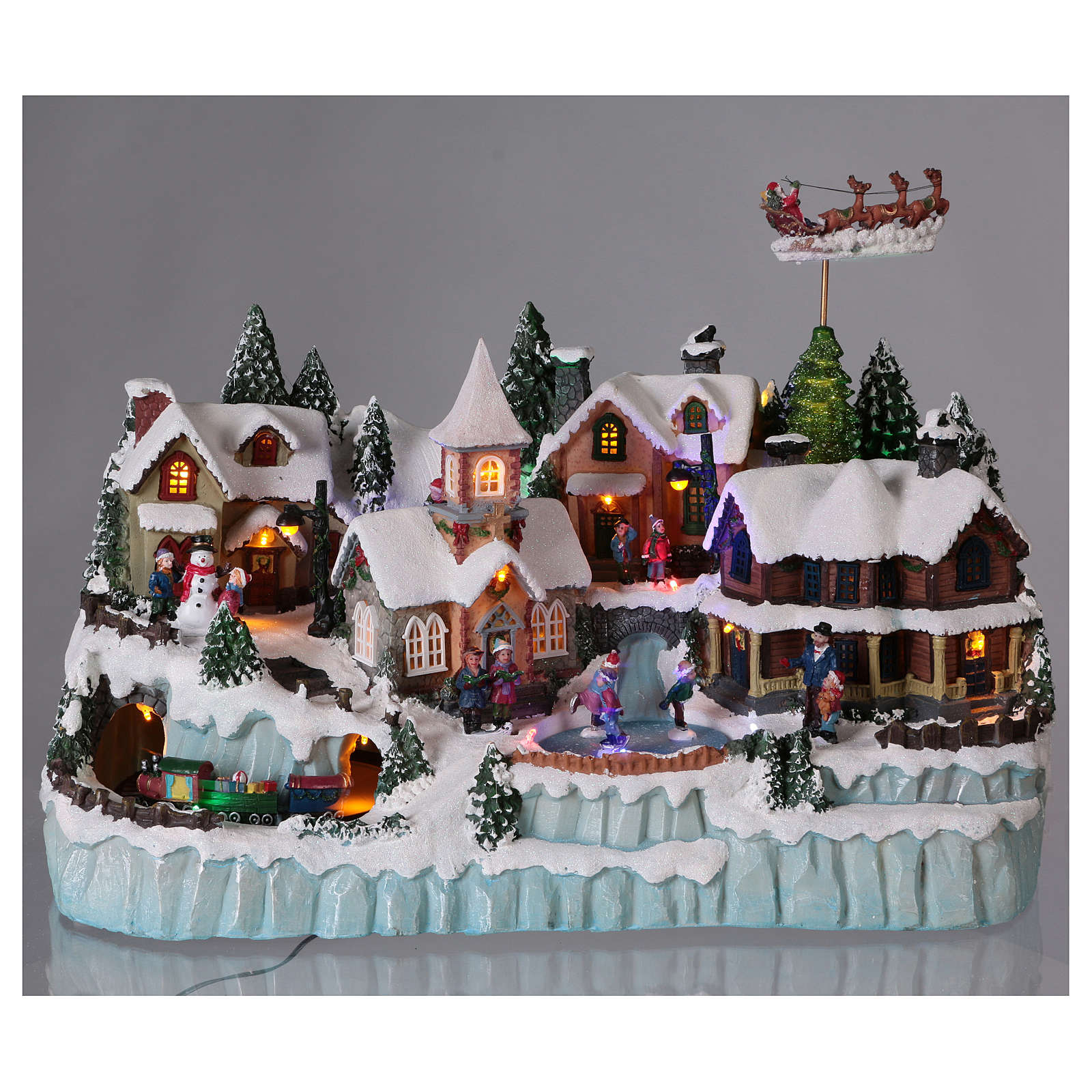 Christmas Villages.Christmas Village With Led Lights Ice Skaters And Moving Train 40x55x30 Cm