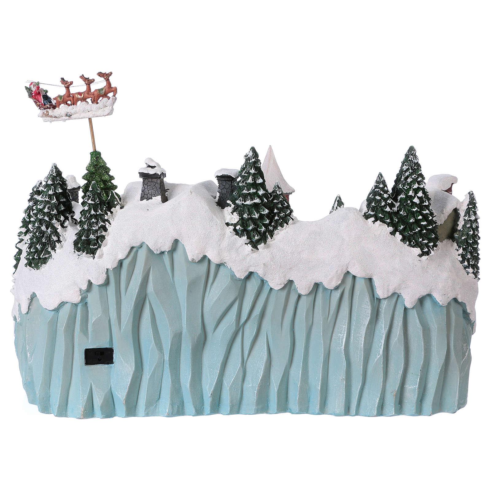 Paesaggio natalizio 40x55x30 cm pattinatori trenino movimento corr 3