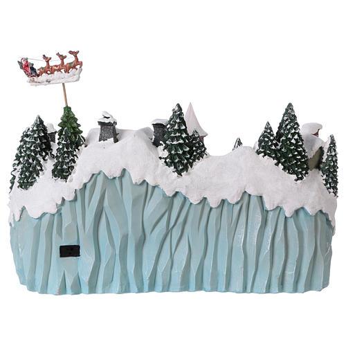 Paesaggio natalizio 40x55x30 cm pattinatori trenino movimento corr 5