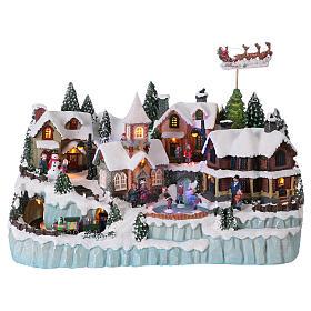 Cenários Natalinos em Miniatura: Cenário natalino 40x55x30 cm patinadores e trem em movimento corrente