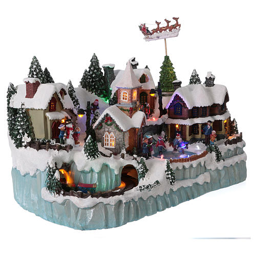 Christmas Village Scene With In Motion Skaters And Train Online Sales On Holyart Com