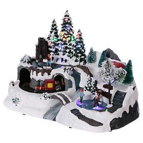 Christmas village with LED lights, moving ice-skaters and train 25x35x20 cm s3