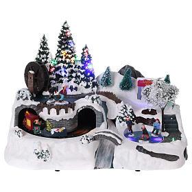Villages de Noël miniatures: Village de Noël 25x35x20 cm train et patineurs en mouvement courant