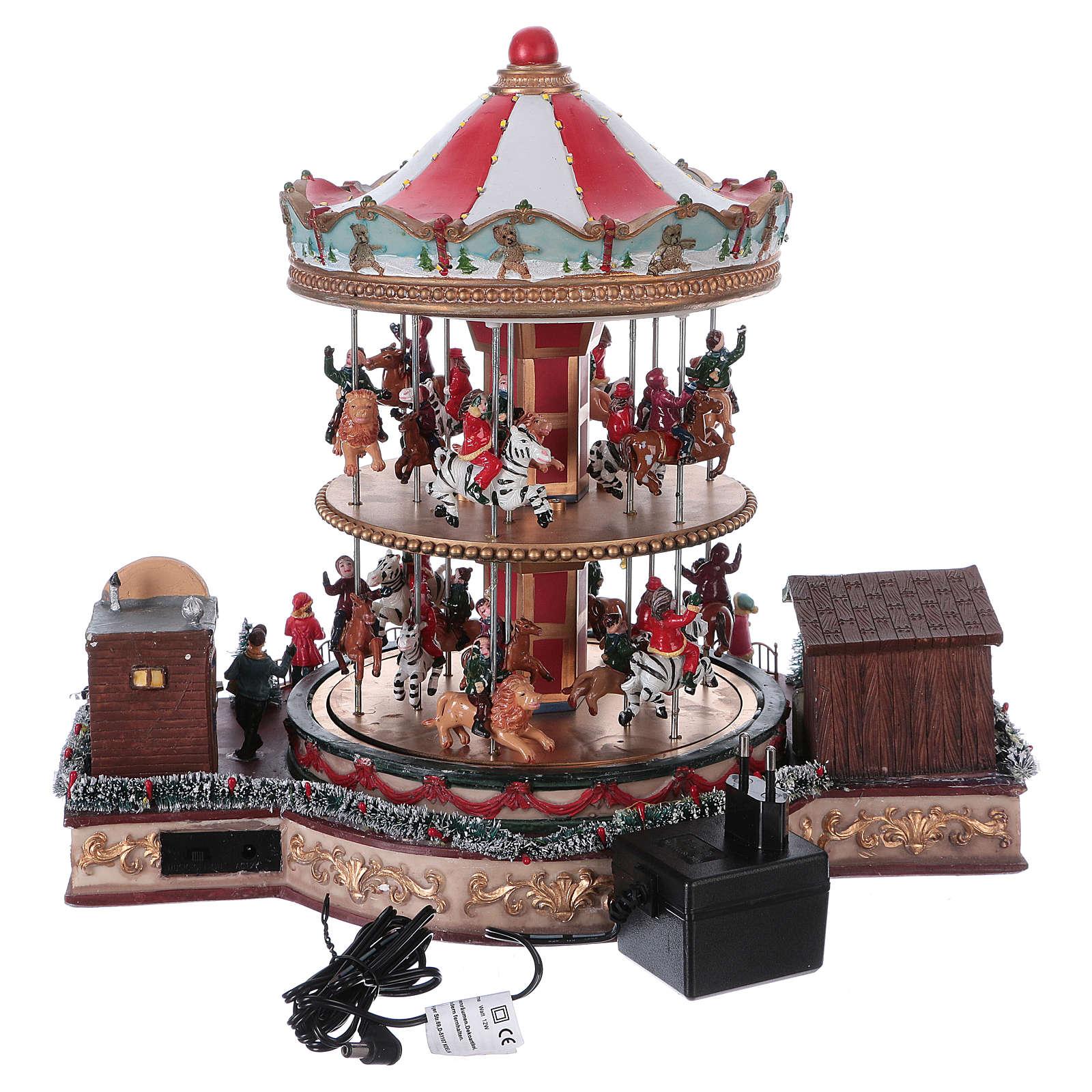 Pueblo navideño iluminado tiovivo en movimiento música 35x40x35 cm corriente 3