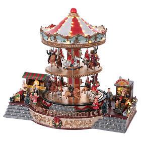 Pueblo navideño iluminado tiovivo en movimiento música 35x40x35 cm corriente s3