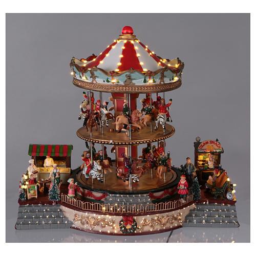 Pueblo navideño iluminado tiovivo en movimiento música 35x40x35 cm corriente 2