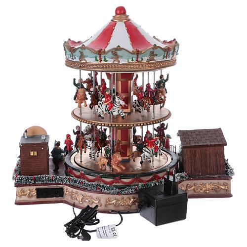 Pueblo navideño iluminado tiovivo en movimiento música 35x40x35 cm corriente 5
