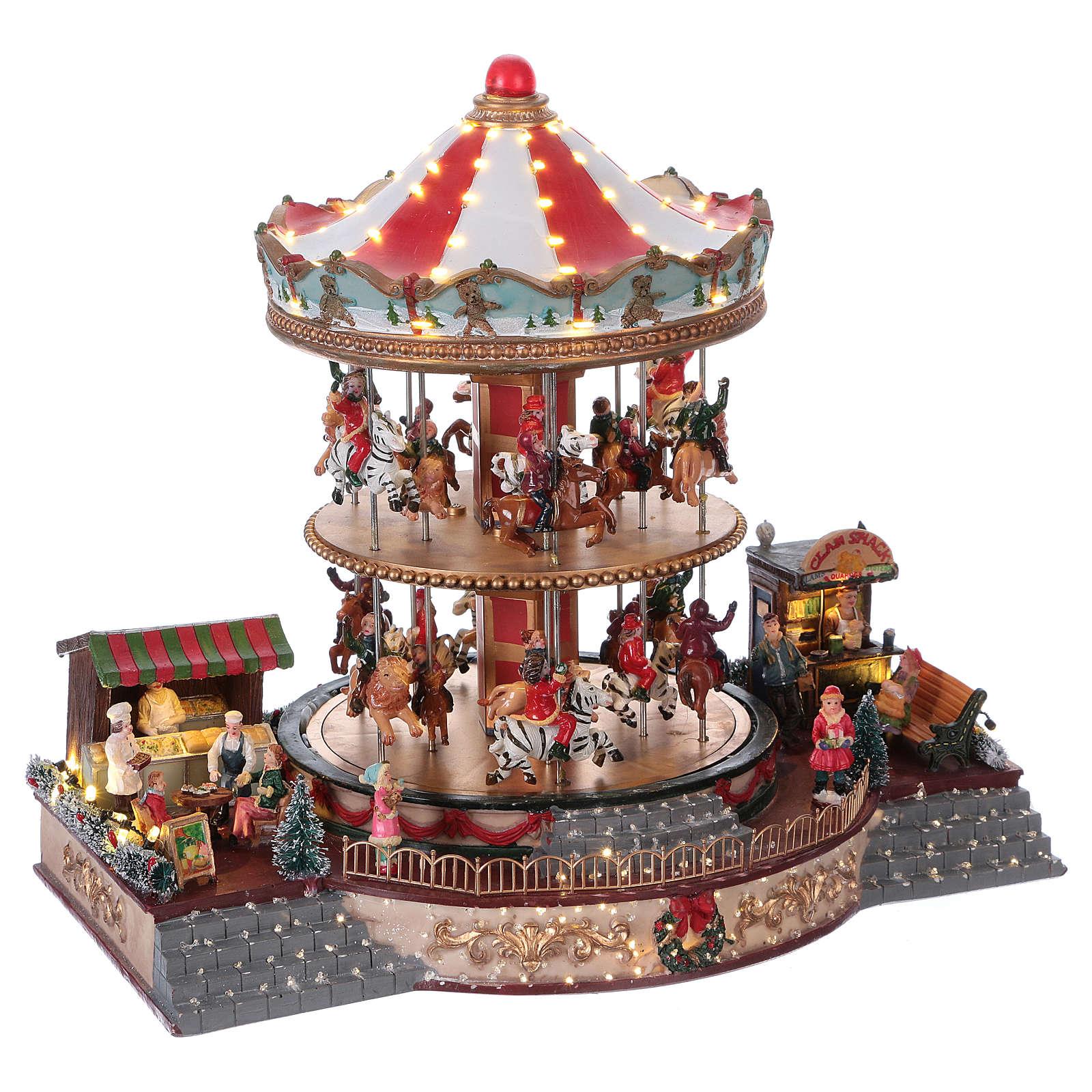 Village Noël éclairé carrousel en mouvement musique 35x40x35 cm courant 3