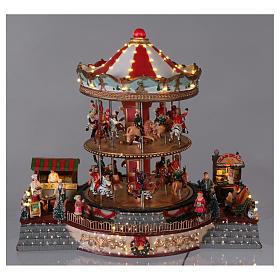 Village Noël éclairé carrousel en mouvement musique 35x40x35 cm courant s2