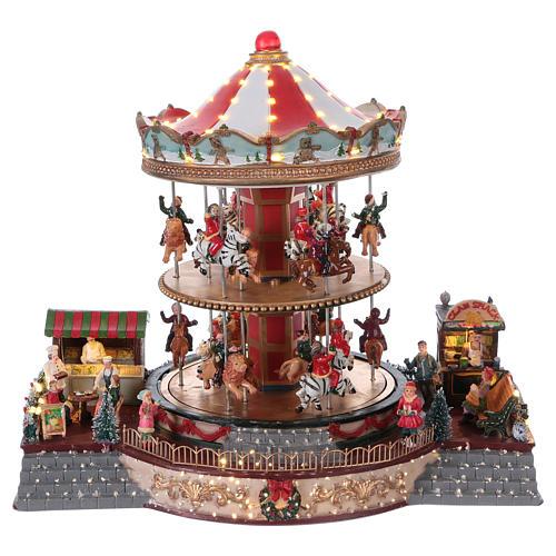 Village Noël éclairé carrousel en mouvement musique 35x40x35 cm courant 1