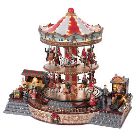 Villaggio natalizio illuminato giostra in movimento musica 35x40x35 cm corrente s3