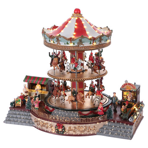 Villaggio natalizio illuminato giostra in movimento musica 35x40x35 cm corrente 3