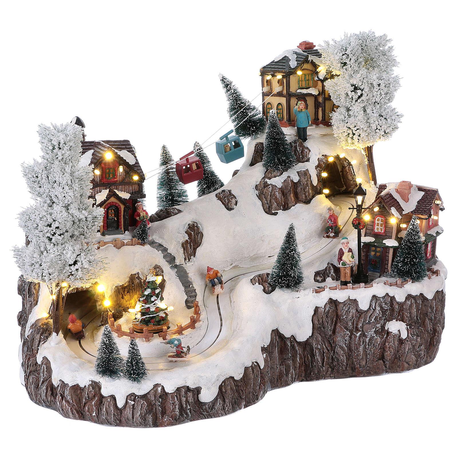 Weihnachtsdorf, mit Beleuchtung, Musik und beweglicher Seilbahn und Abfahrtsläufern, 35x45x30 cm, Netzanschluss 3