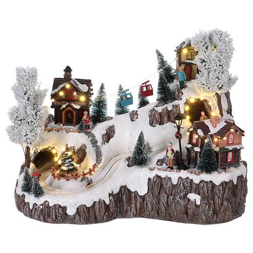 Weihnachtsdorf, mit Beleuchtung, Musik und beweglicher Seilbahn und Abfahrtsläufern, 35x45x30 cm, Netzanschluss 1