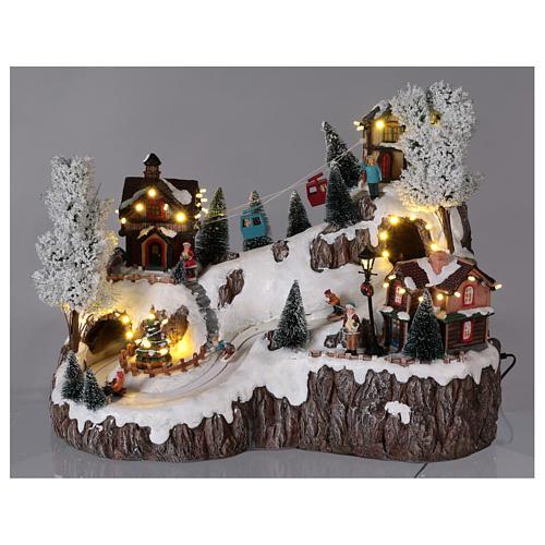 Weihnachtsdorf, mit Beleuchtung, Musik und beweglicher Seilbahn und Abfahrtsläufern, 35x45x30 cm, Netzanschluss 2