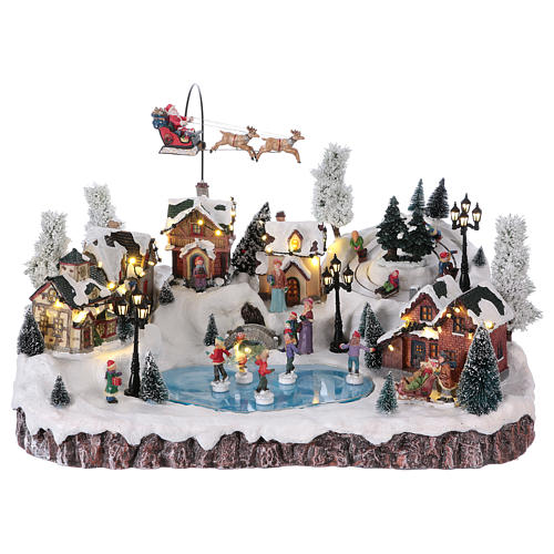 Christmas village with music, movement and lights 30x50x35 cm 1