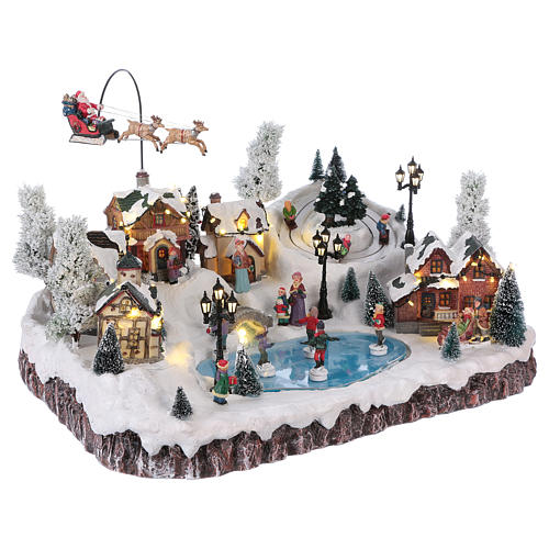 Christmas village with music, movement and lights 30x50x35 cm 4