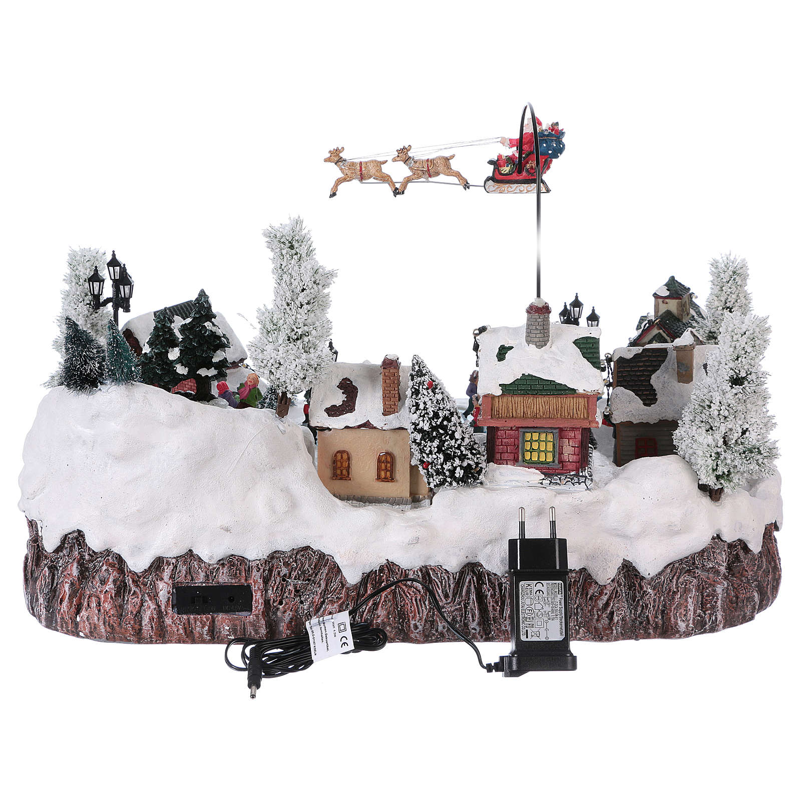 Pueblo de Navidad música y movimiento y luces 30x50x35 cm corriente 3