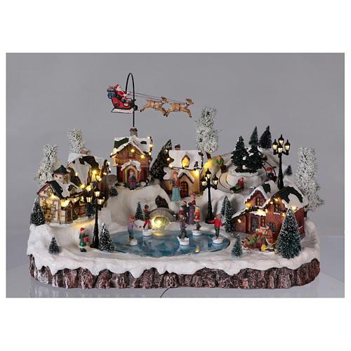 Pueblo de Navidad música y movimiento y luces 30x50x35 cm corriente 2
