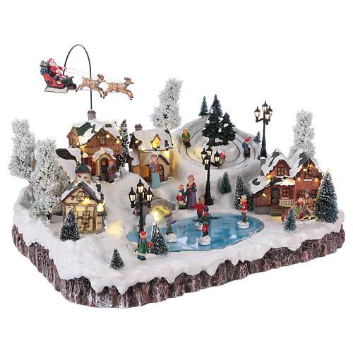 Pueblo de Navidad música y movimiento y luces 30x50x35 cm corriente 4