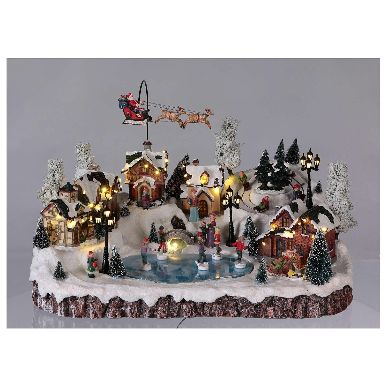 Villaggio di Natale musica e movimento e luci 30x50x35 cm corrente 3