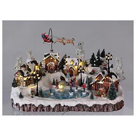 Villaggio di Natale musica e movimento e luci 30x50x35 cm corrente s2