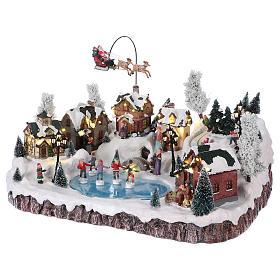 Villaggio di Natale musica e movimento e luci 30x50x35 cm corrente s3