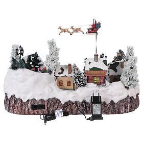 Villaggio di Natale musica e movimento e luci 30x50x35 cm corrente s5