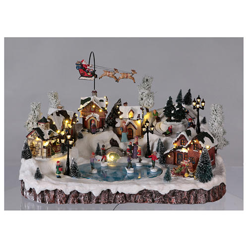 Villaggio di Natale musica e movimento e luci 30x50x35 cm corrente 2