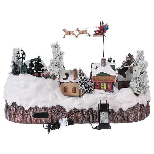 Villaggio di Natale musica e movimento e luci 30x50x35 cm corrente 5