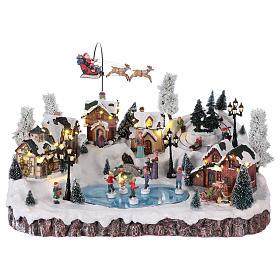 Cenários Natalinos em Miniatura: Cénario de Natal música movimento luzes 30x50x35 cm