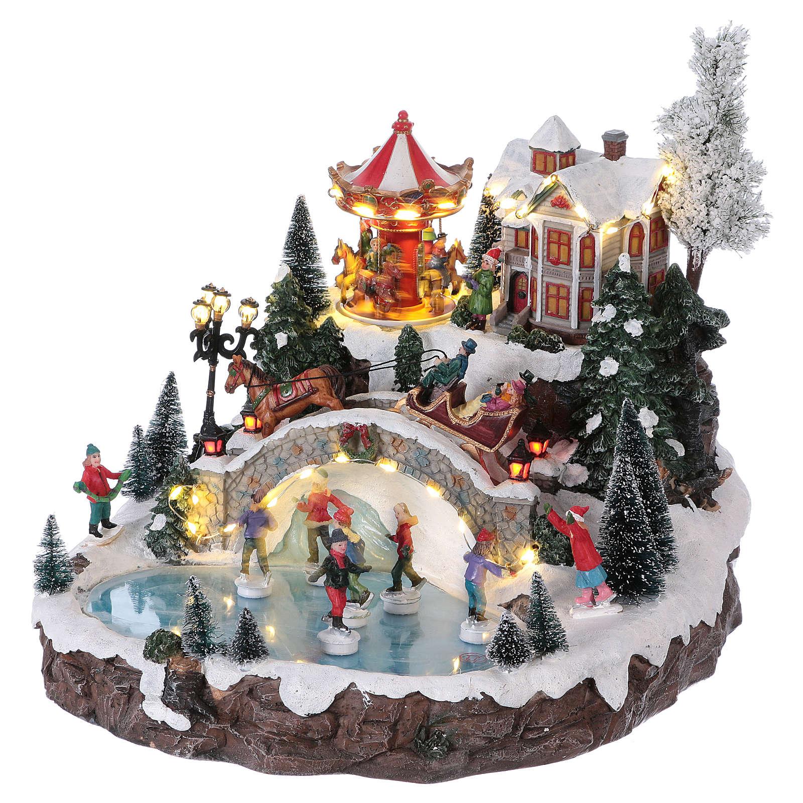 Weihnachtsdorf, mit Beleuchtung, Musik und beweglichen Eisläufern und kleinem Karussell, 30x35x35 cm, Netzanschluss 3