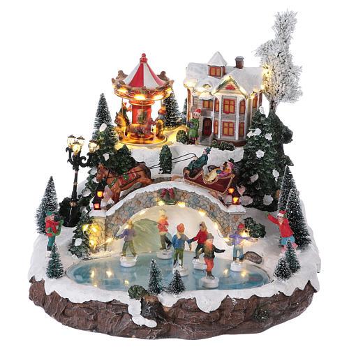 Weihnachtsdorf, mit Beleuchtung, Musik und beweglichen Eisläufern und kleinem Karussell, 30x35x35 cm, Netzanschluss 1