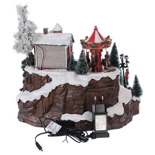 Weihnachtsdorf, mit Beleuchtung, Musik und beweglichen Eisläufern und kleinem Karussell, 30x35x35 cm, Netzanschluss 5