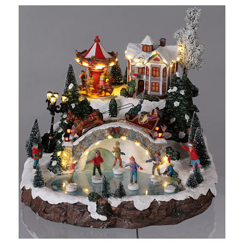 Christmas village with lights, music and movement 30x35x35 cm 2