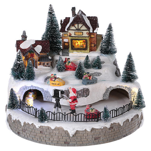 Christmas village with Santa Claus, lights, music and movement 20x25x25 cm 1