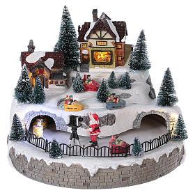 Village hivernal Père Noël lumières mouvement musique 20x25x25 cm courant s1