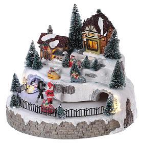 Village hivernal Père Noël lumières mouvement musique 20x25x25 cm courant s3