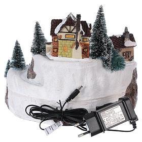 Village hivernal Père Noël lumières mouvement musique 20x25x25 cm courant s5