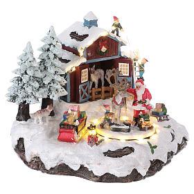 Pueblo de Navidad Papá Noel regalos 20x25x20 cm luces movimiento música corriente s4