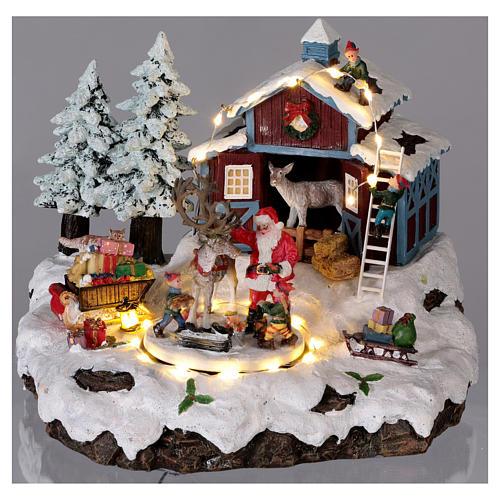 Pueblo de Navidad Papá Noel regalos 20x25x20 cm luces movimiento música corriente 2