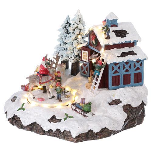 Pueblo de Navidad Papá Noel regalos 20x25x20 cm luces movimiento música corriente 3
