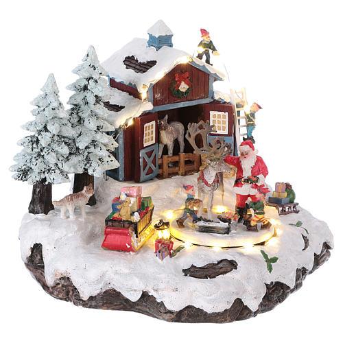 Pueblo de Navidad Papá Noel regalos 20x25x20 cm luces movimiento música corriente 4