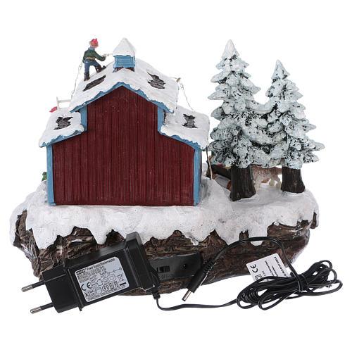 Pueblo de Navidad Papá Noel regalos 20x25x20 cm luces movimiento música corriente 5