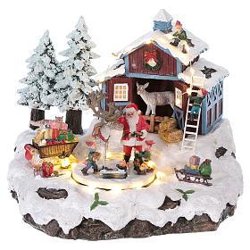 Cenários Natalinos em Miniatura: Cenário de Natal Pai Natal presentes 20x25x20 cm luzes movimento música corrente