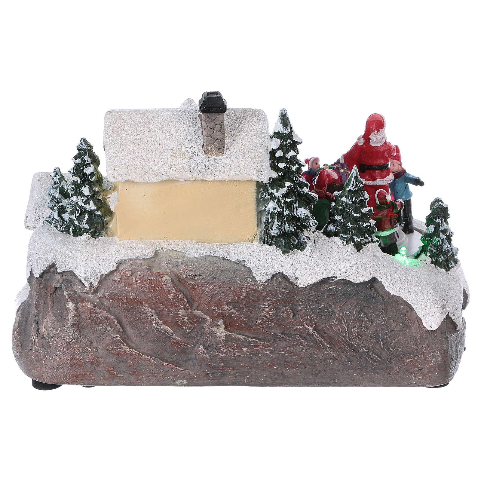Pueblo navideño 15x20x15 cm luces y movimiento batería 3