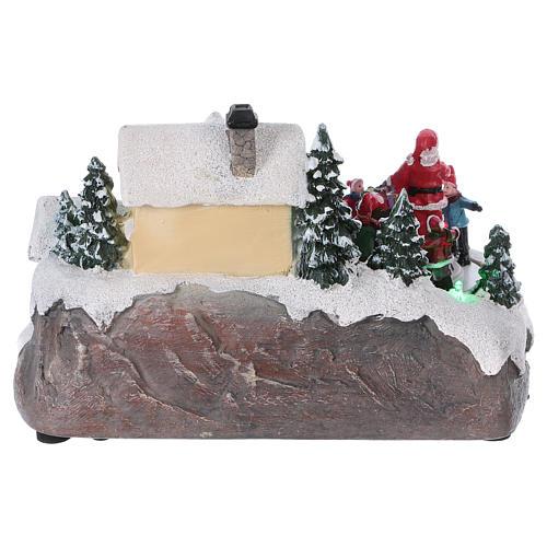 Pueblo navideño 15x20x15 cm luces y movimiento batería 5