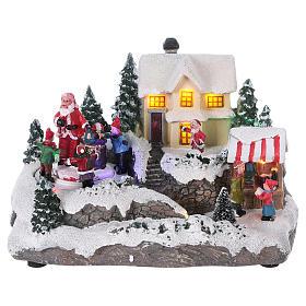 Village de Noël 15x20x15 cm lumières et mouvement piles s1