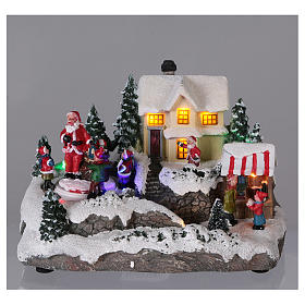 Village de Noël 15x20x15 cm lumières et mouvement piles s2